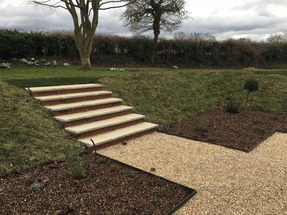 steps through sloping garden