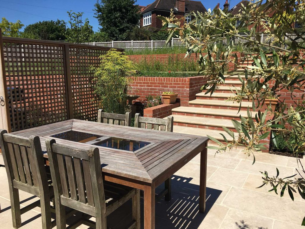 garden seating area with timber furniture