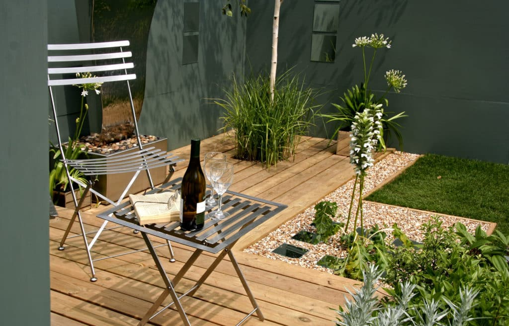 small garden with deck and seating