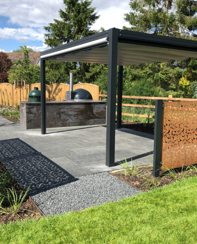 beautiful modern garden in Danbury with contemporary pergola, outdoor kitchen and corten steel screens