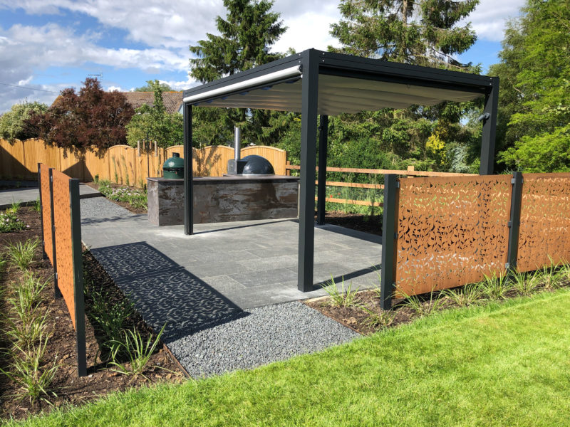 beautiful modern garden in Danbury with contemporary pergola, outdoor kitchen and corten steel screens