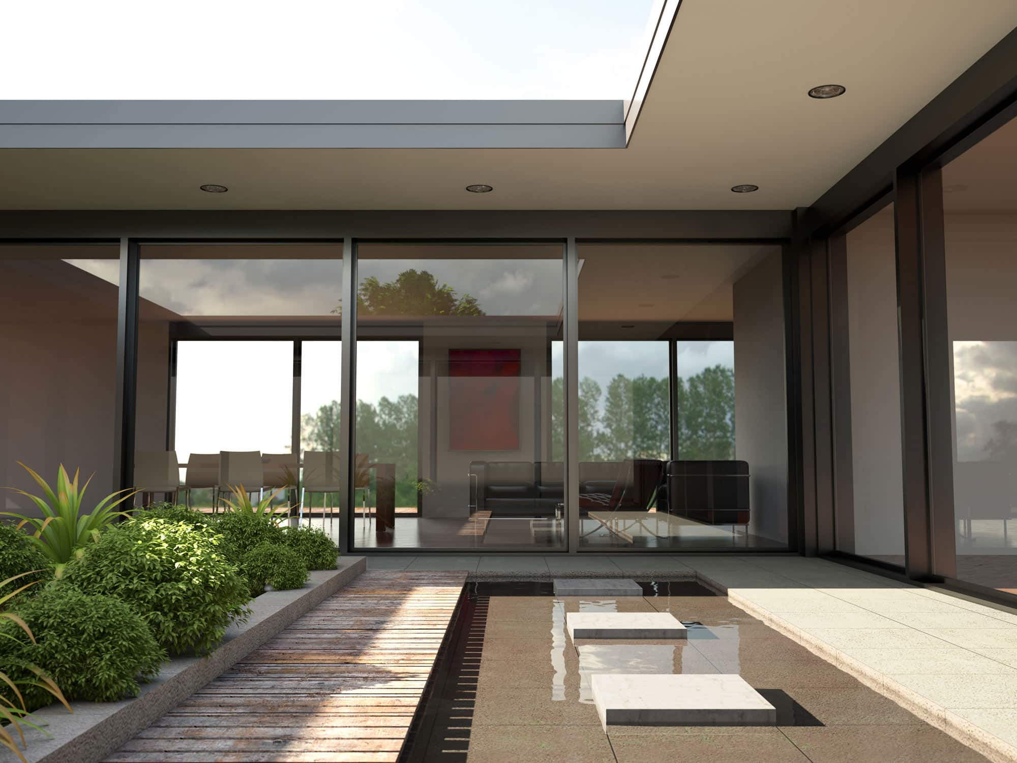 courtyard garden with shallow pool surrounded by bifold doors in modern building