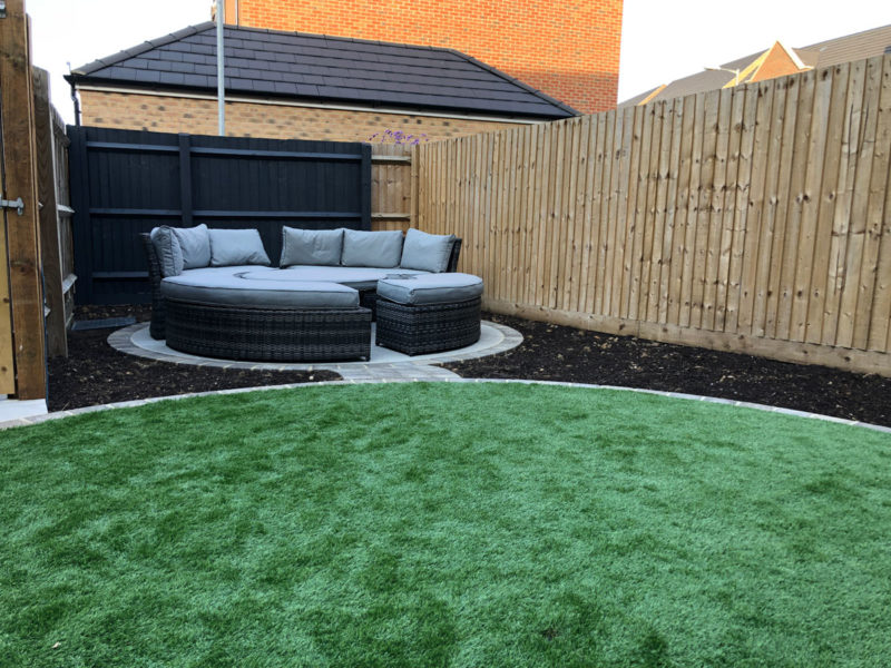 seating area and circular artificial grass lawn