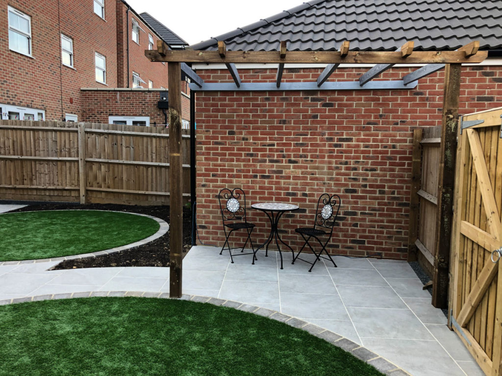 back garden with circular lawns and seating area