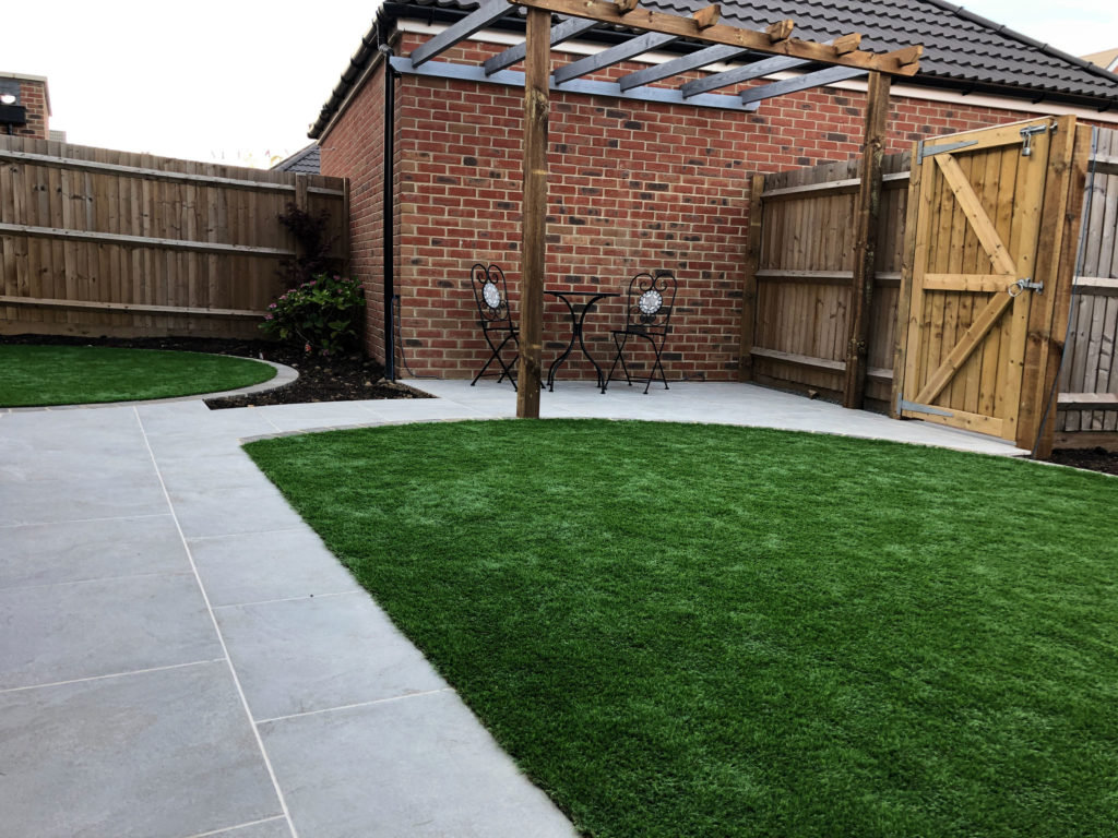 back garden with artificial grass and timber pergola