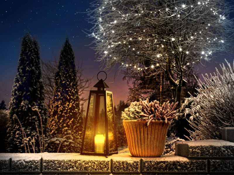 outdoor christmas lights with candle lantern