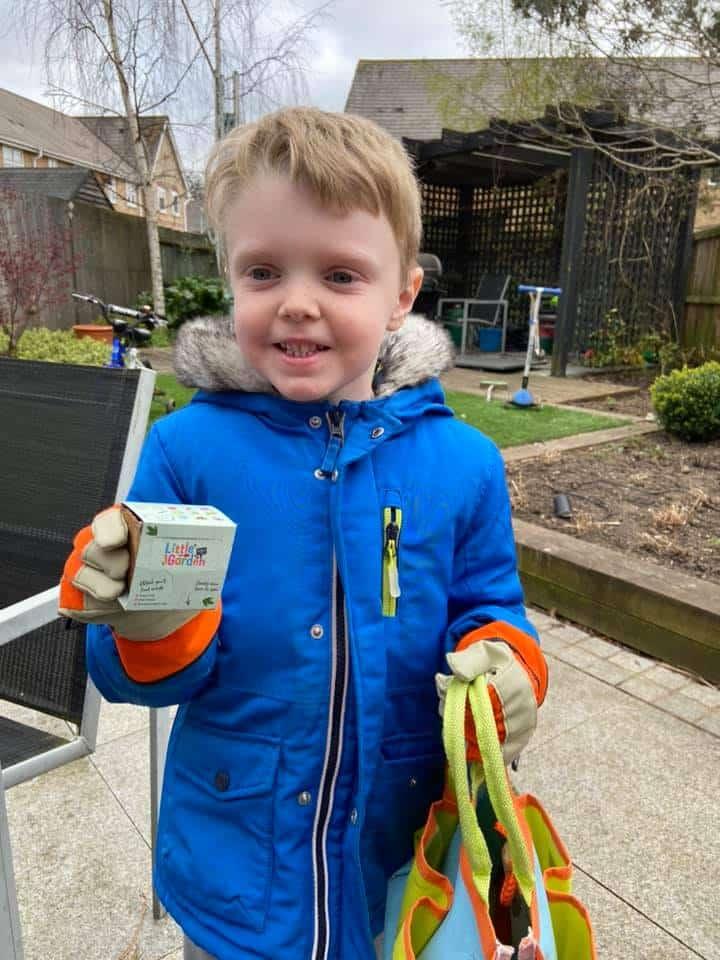 homeschooling in the garden planting seeds