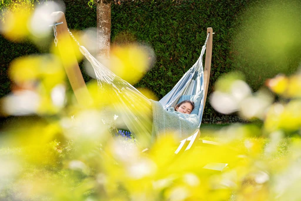 lady sleeping in garden hammock