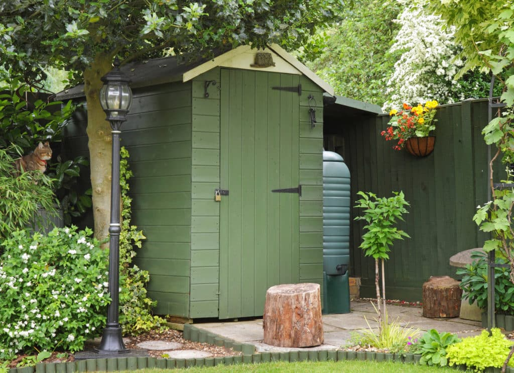 timber garden shed painted green and cream