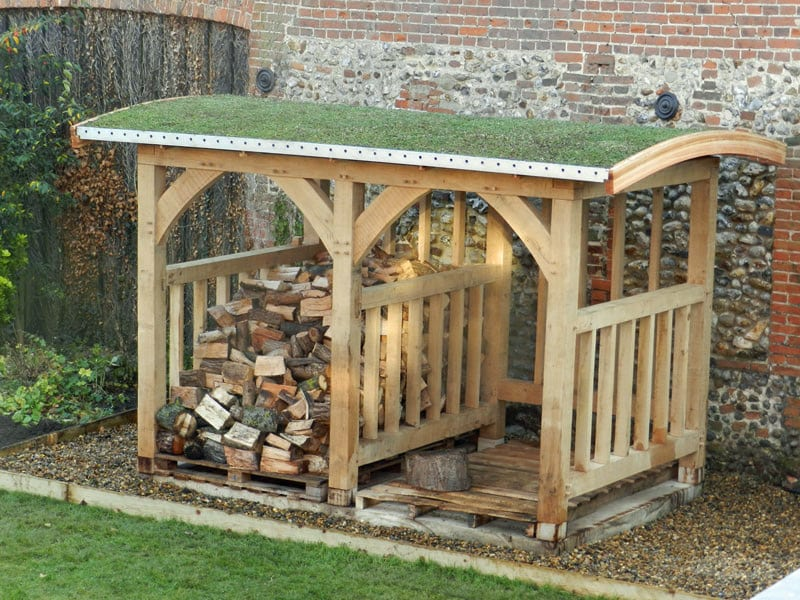 rustic style garden storage for logs has a living green roof