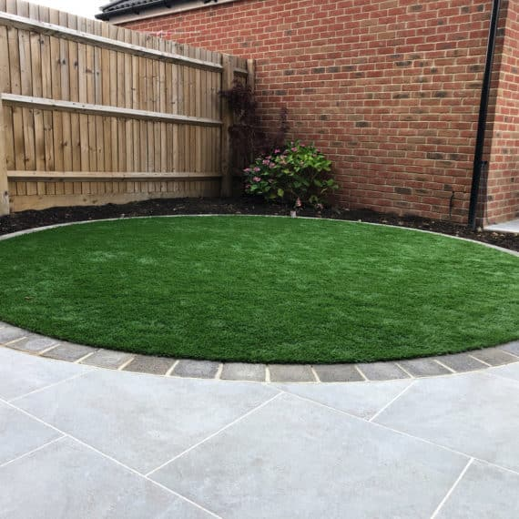 circular artificial grass lawn in modern back garden