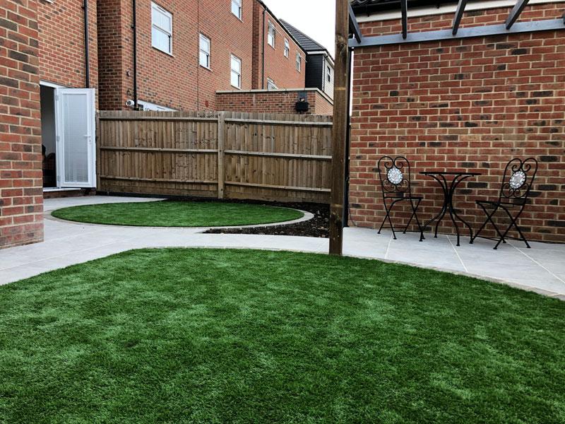 modern back garden with artificial grass lawns