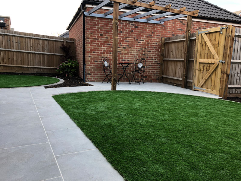 modern back garden layout with semi circular lawn and timber pergola