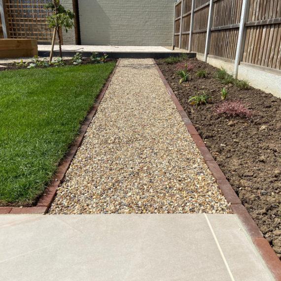 gravel path edged with brick pavers