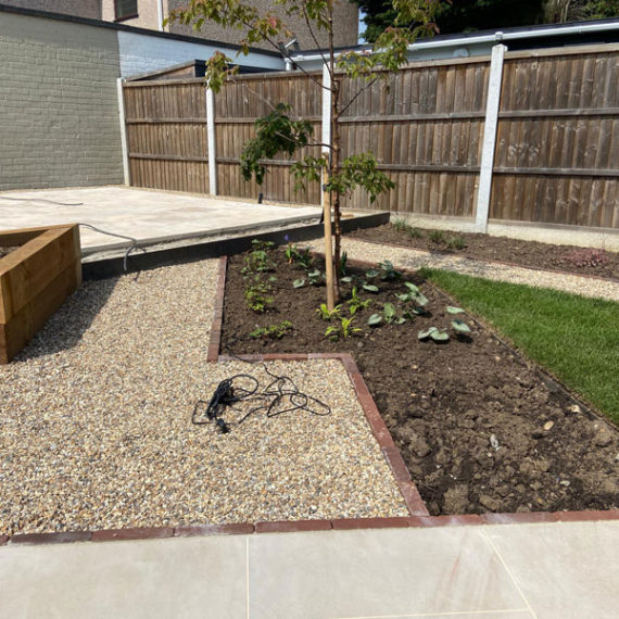 hard landscaping with gravel path joining two porcelain patios