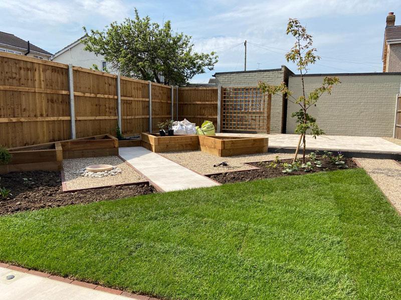 triangular lawn leading to triangular patio