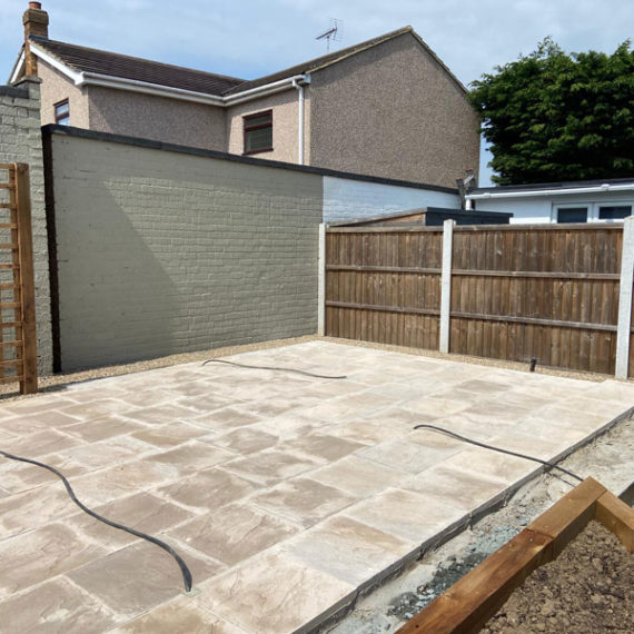 part built porcelain patio with wiring in place for lights