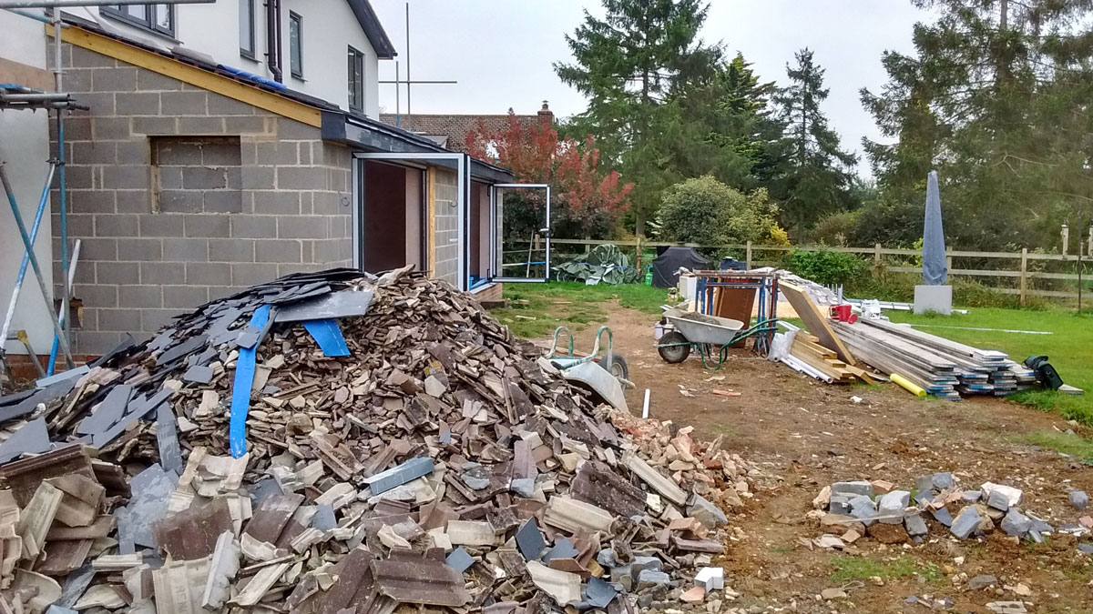 house extension with pile of rubble