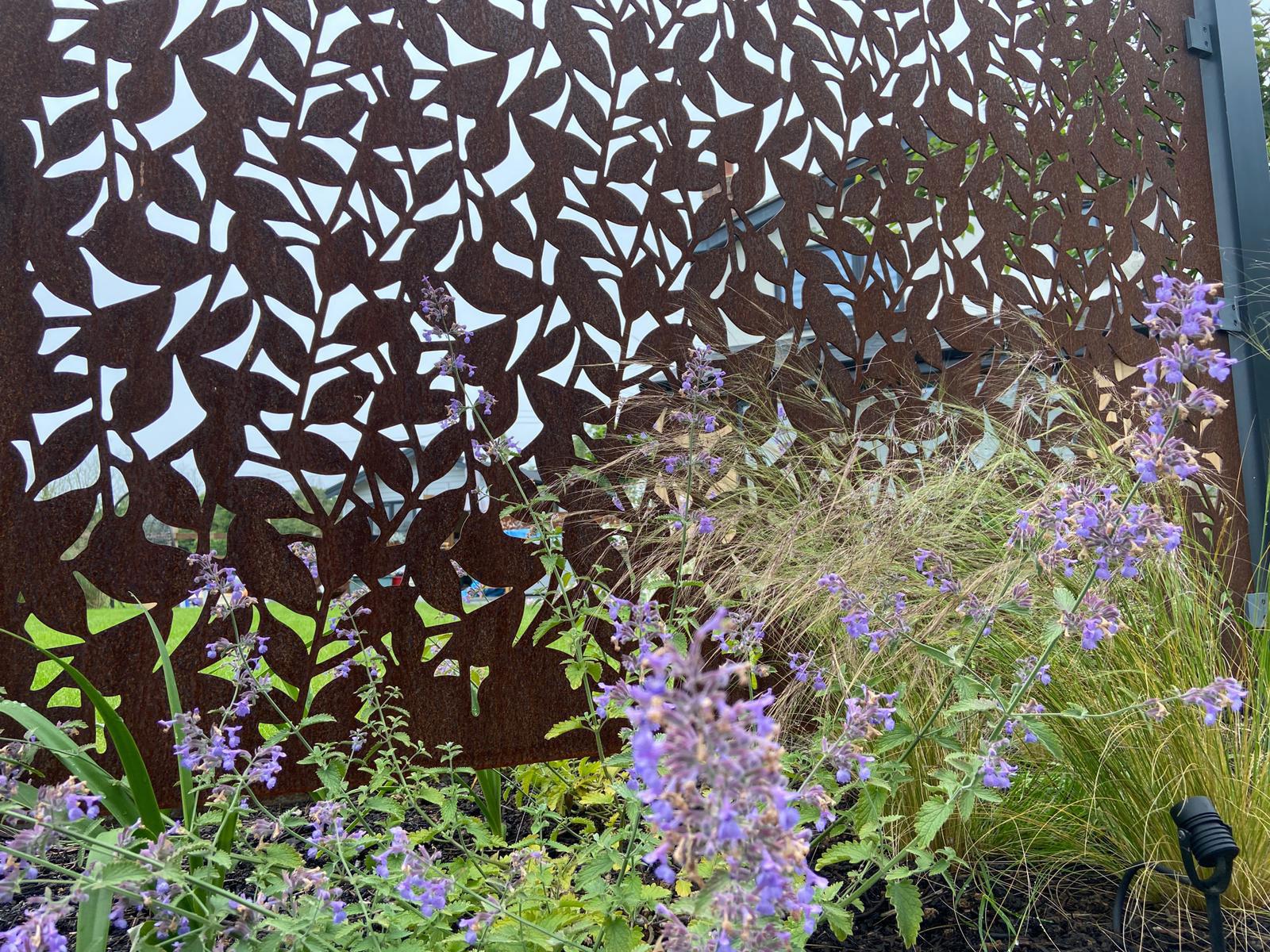 corten metal garden screen with leaf design