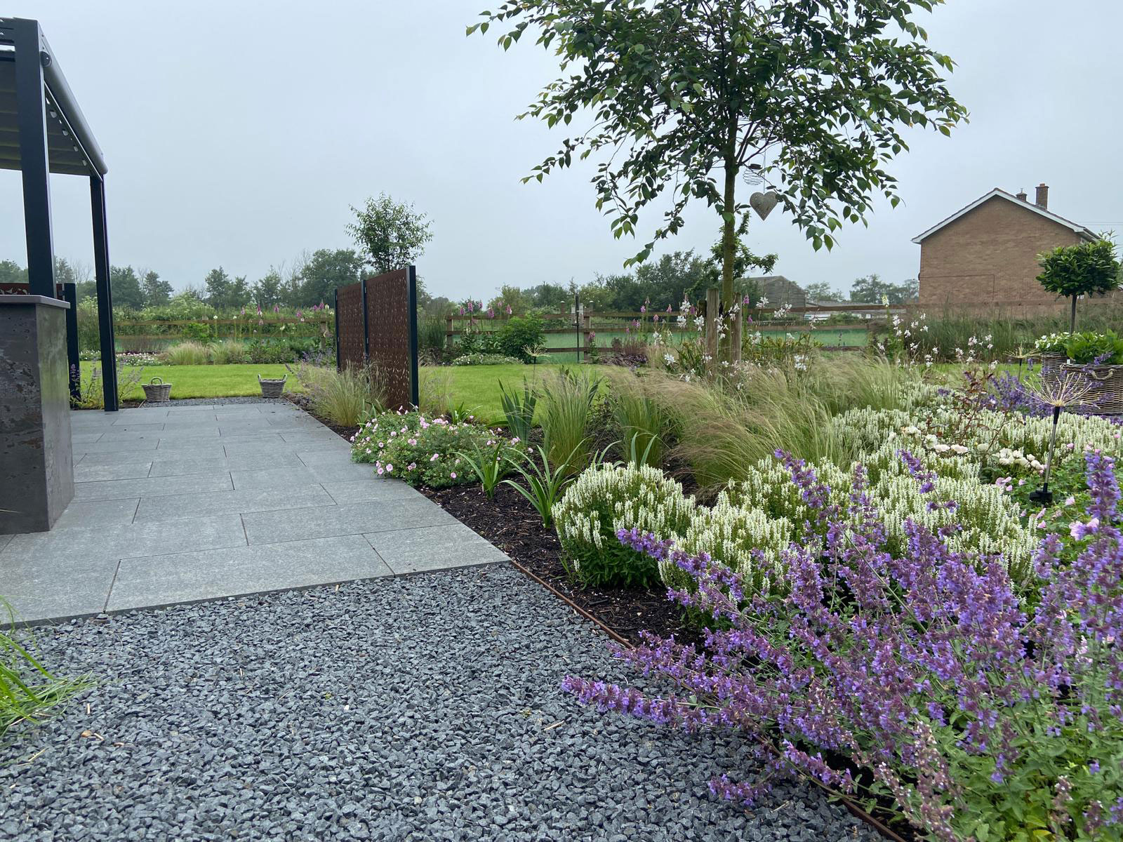 landscaping surfaces in neutral colour with purple and white planting