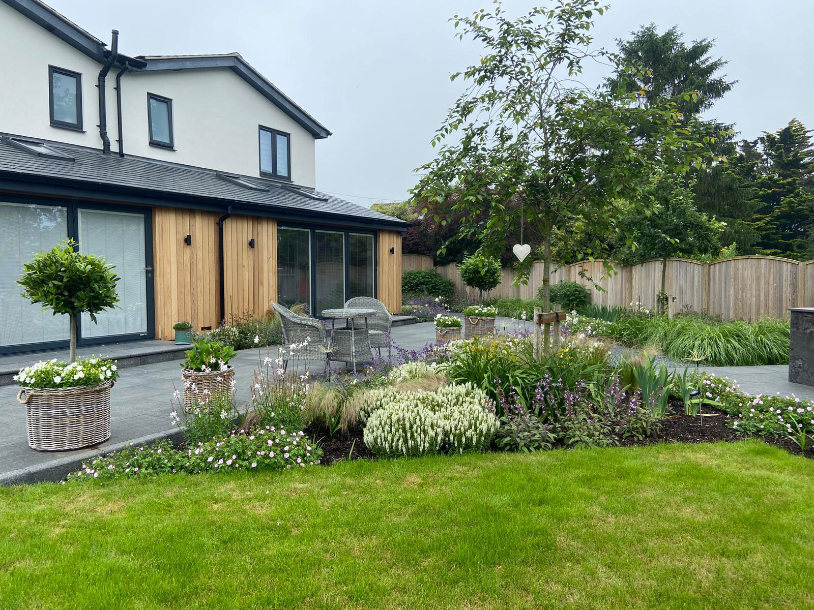 modern house with lawns and beautiful planting scheme