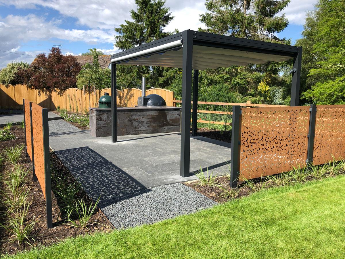 modern pergola with louvred roof and corten garden screening